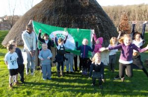 Pupils at Moulsecoomb Primary celebrate their Green Flag award.